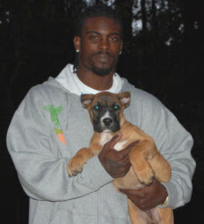 Michael Vick with puppy. We wonder where this little pooch is now?