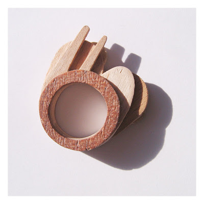 Wooden ring which incorporates lolly sticks and a wooden chip fork.