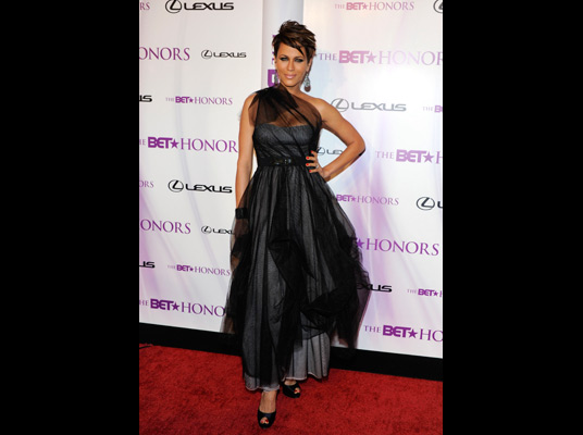 Nicole Ari Parker in a one shoulder, chiffon overlay gown.