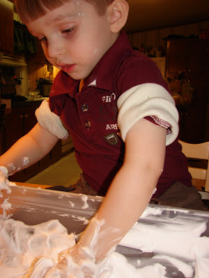 Messy play in shaving cream sensory bin