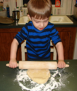 Having fun rolling out cookie dough