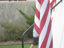 Our grandson - hidden (covered) by the U.S. flag.
