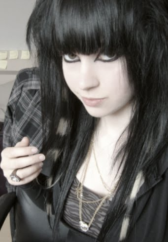 Cute emo girl with long black hair, cute heavy bangs and coontails for
