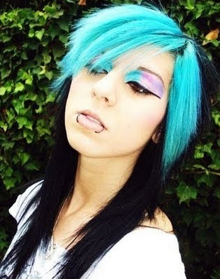 Gorgeous blue and black emo hairstyle. This girls eye make-up matched her