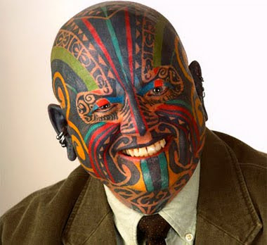 Colorful face tattoo Colorful face tattoo Posted by art designs at 712 AM