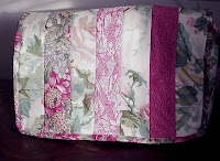 Quilted sewing machine cover using jelly roll strips