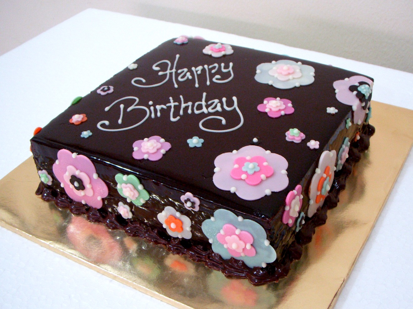 Bearylicious cakes chocolate mousse cake with chocolate flowers this birthday cake is the chocolate hazelnut mousse cake covered with dark chocolate glaze the floral decorations are made with chocolate izmirmasajfo