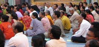 Devotees chanting at Radha Madhav Dham