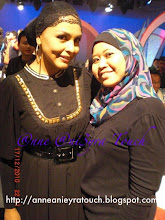 WITH NORYN AZIZ