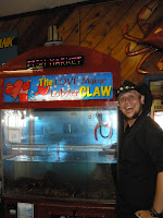 A picture of Mr Jerkface and the lobster claw game at the San Pedro fish market
