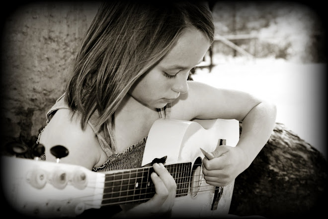 Lexi playing her guitar