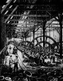 Los obreros ingleses trabajando en una fábrica.