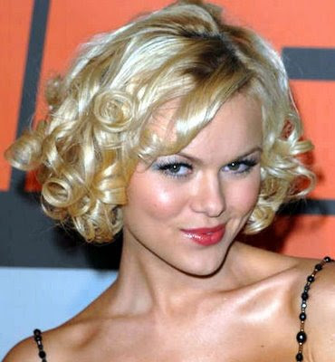 mid length hairstyles for women. A curly hair 2010 Medium