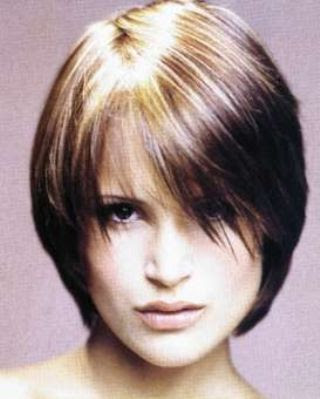 short hairstyles with side bangs. Ashlee Simpson's long sleek layers with