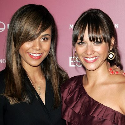 Sleek and short with side-swept bangs,; side