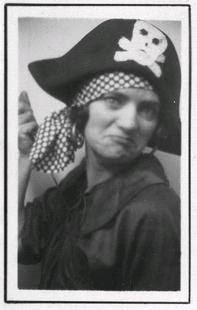 Young 1920's-era woman dressed as a pirate