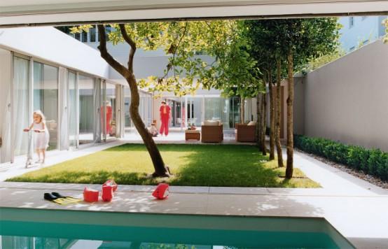 Modern House With Garden Behind Walls 3 554x356