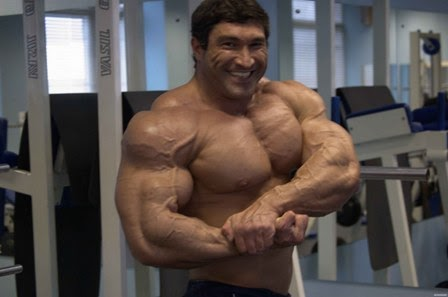 Handsome hard metal muscles and big body russian bodybuilder