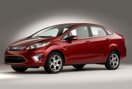 Front 3/4 view of red 2011 Ford Fiesta sedan
