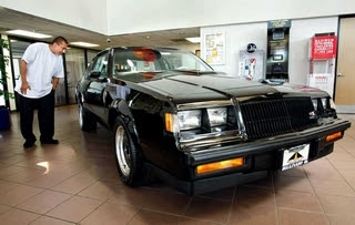 1987 black Buick Regal GNX on showroom floor in 2011