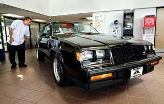 1987 black Buick Regal GNX on showroom floor in 2011