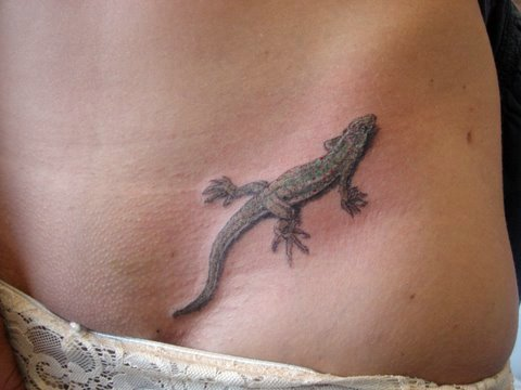 but cannot seem to think of the perfect lizard tattoo design,