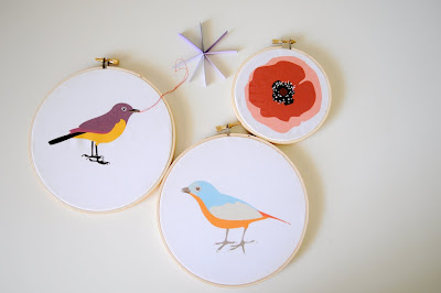 birds in embroidery hoops