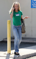 Kendra Wilkinson in green top & jeans