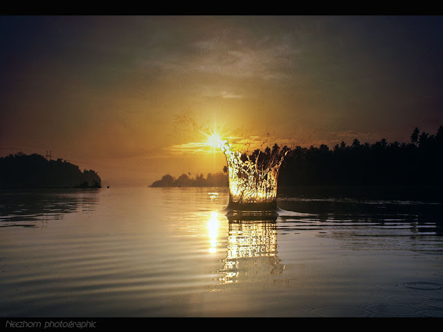 Water splash touch the sun picture
