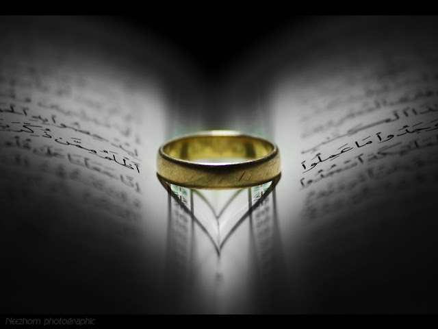 gold ring on the quran macro