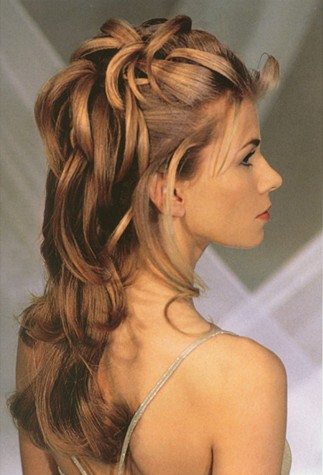 Elizabeth Hurley hairstyle with tiara.
