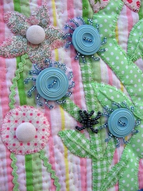 button tin and had fun making these precious old buttons into flowers