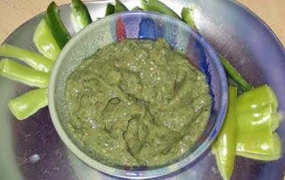 Homemade tomatillo salsa with home-grown pepper strips