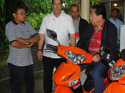 Willy Dela Cruz of Eagle Motorcycles, Dave Dewbre and Chavit Singson in Subic Bay Freeport.