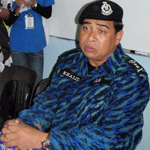 Police chief Khalid,fat,droopy eyes