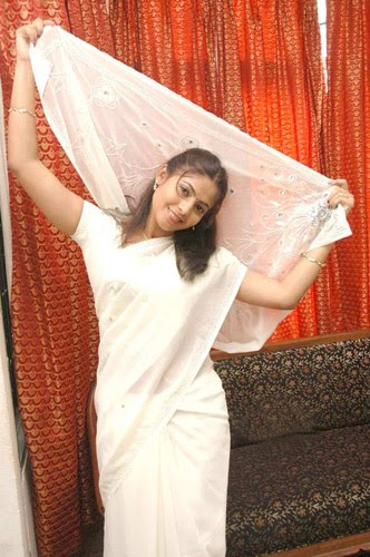 saira looking cool in white saree hot images