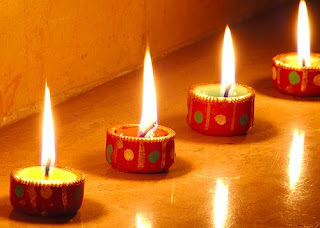 row of diwali diyas