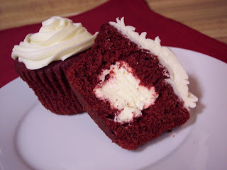 red velvet cupcakes with filling in the middle