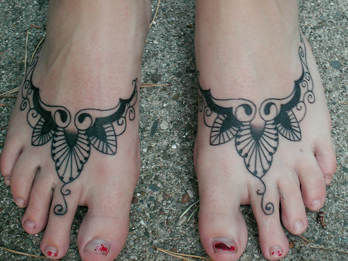 tattoo s. lettering tattoos on foot.