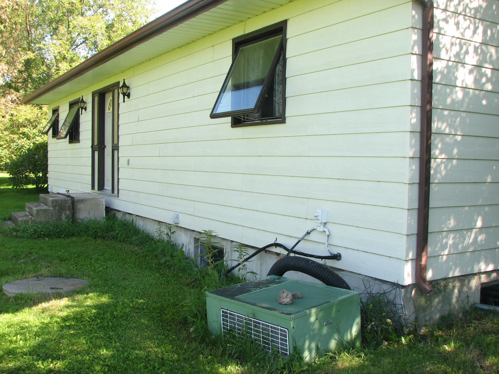 My Acreage: Basement Windows and Air Conditioning Unit #7F903B
