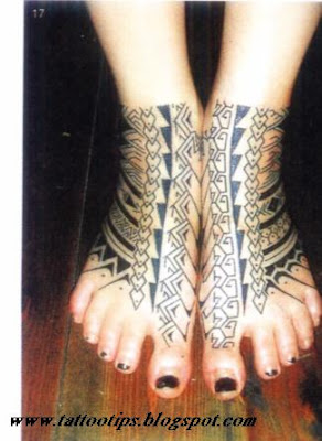 Tribal tattoos on foot of bilateral woman beside