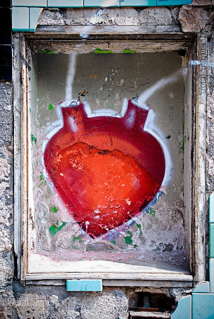 graffti of a red heart, vaguely realistically drawn