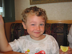 Sean eating a lemon at Olgas
