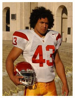 CAPTION: Troy Polamalu. Bringin' sexy short hair back?