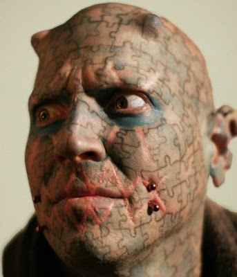 Most Unusual And Weird Face Tattoos Seen On www.coolpicturegallery.us