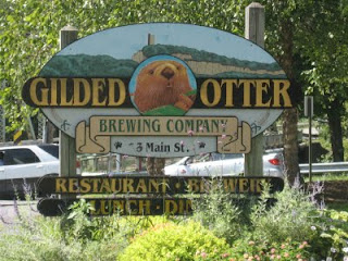 Gilded Otter sign