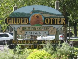 Gilded Otter sign
