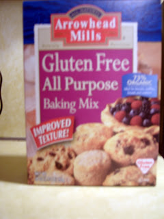 A box of Gluten Free All Purpose Baking Mix. It's a blue box with all sorts of pastries on the front of it