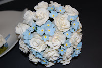 forget me not flowers and roses wedding bouquet