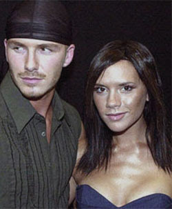 Beckham eyes ex-model, Posh walks out